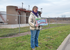 Susie Beiersdorfer standing in front of Northstar 1 deep injection well in Youngstown, Ohio. (Image: Dimiter Kenarov)