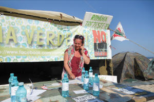 In the seaside village of Vama Veche, Romania, Rodica Cruceanu collects signatures to push for a parliamentary commission to investigate the environmental impact of fracking. (Image: Dimiter Kenarov)