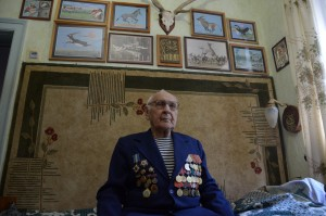 NIkolai Lobanov, 90, a veteran of the Battle of Stalingrad  and one of the fathers of Askania-Nova's  Przewalski's horse breeding and conservation program.  Lobanov is also an accomplished artist,  as the paintings behind him attest. Photo by: Dimiter Kenarov
